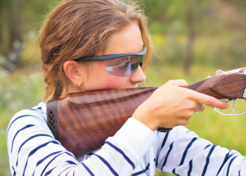Woman shooting rifle